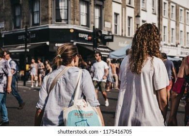 London, UK - July 21, 2018: People walk on Portobello Road Market, Notting Hill, London. Portobello Road is the world's largest antiques market with over 1,000 dealers.