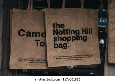 London, UK - July 21, 2018: Jute bag by The Notting Hill Shopping Bag Company on sale at Portobello Road Market. Its images designed by local artists and benefit and promote Notting Hill.