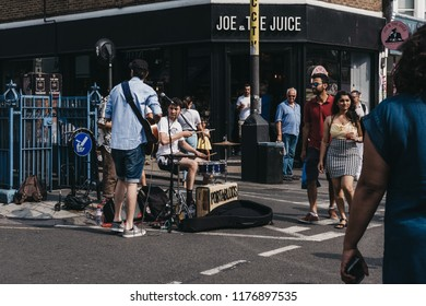 London, UK - July 21, 2018: Portabloos band performing at Portobello Road Market, Notting Hill, London. Portobello Road is the world's largest antiques market with over 1,000 dealers.