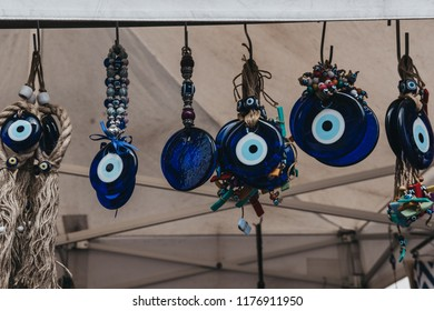 London, UK - July 21, 2018: Nazar amulets on sale on a stall at Portobello Road Market, Notting Hill, London. Portobello Road is the world's largest antiques market with over 1,000 dealers.