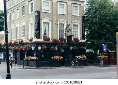 London, UK - July 23, 2018: The Mitre is a local Greenwich Pub. A well-established Greenwich watering hole, perched on a street corner near St Alfege's Church