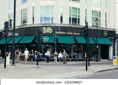 London, UK - July 23, 2018: Bill's Greenwich Restaurant is positioned on the corner of the bustling Nelson Road and Greenwich Church Street