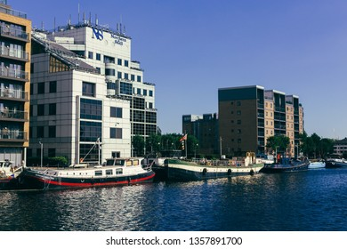 London, UK - July 23, 2018: Houseboats moored in the Millwall Outer Dock , Isle of Dogs. Housebat is a boat that has been designed or modified to be used primarily as a home