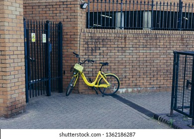 London, UK - July 23, 2018: Yellow Ofo bikes on a street in London. Ofo is a dockless bike-sharing company that deployed over 10 million bicycles in 250 cities and 20 countries
