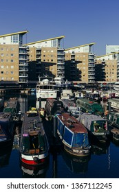 London, UK - July 23, 2018: Houseboats moored in the Limehouse Basin that provides a navigable link between the Regent's Canal and the River Thames, through the Limehouse Basin Lock