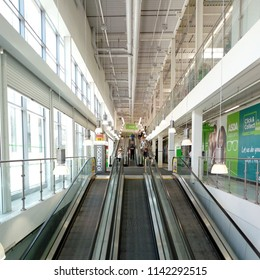 LONDON/ UK- JULY 24 2018: Shoppers using the double escalator entrance, to the new asda superstore, in Barking town centre, London