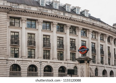 London, UK - July 24, 2018: London Underground sign for Bank station, City of London, against a building on Lombard Street. London Underground is the oldest underground railway in the world.