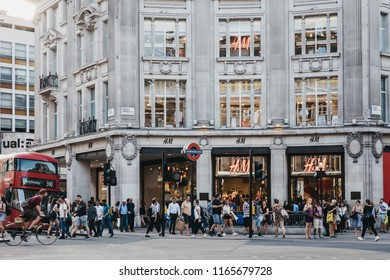 London, UK - July 24, 2018: People walking in front of flagship H&M store on Oxford street near entrance to Oxford Circus tube station, the busiest rapid-transit station in the United Kingdom.