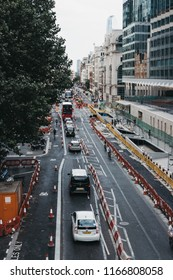 London, UK - July 24, 2018: Traffic queuing in one lane because of the roadworks on a street in the City of London, London's famous financial district.