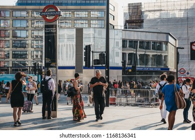 London, UK - July 24, 2018: People walking near Tottenham Court Road, London, at sunset. Tottenham Court Road is a London Underground and a future Elizabeth line station in West End of London.