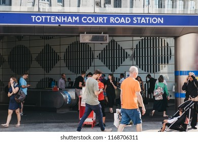 London, UK - July 24, 2018: People walking past Tottenham Court Road station, London, UK. Tottenham Court Road is a London Underground and a future Elizabeth line station in West End of London.