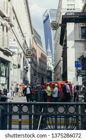 London / UK - July 24, 2018: Lombard Street viewed from the Bank Junction, Walkie-Talkie building on the background. Lombard street has often been compared with Wall Street in NY