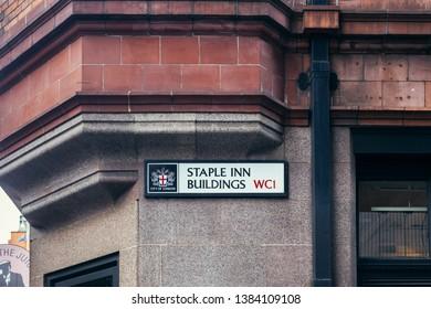 London / UK - July 24, 2018: Staple INN Buildings name sign. Staple Inn is a Tudor building on the south side of High Holborn street in the City of London, London, England