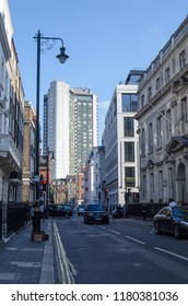 LONDON, UK - JULY 25, 2017:  View along South Audley Street in the wealthy district of Mayfair, Central London.  The tall Park Lane Hilton Hotel dominates the skyline.