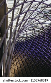 London, UK - July 26, 2018: Low angle view of a contemporary roof by  John McAslan + Partners inside King's Cross station, one of the largest railway stations in London and a significant transport hub