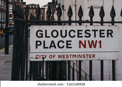 London, UK - July 26, 2018: Gloucester Place name sign on a building wall in the City of Westminster, London borough which occupies much of the central area of London and also holds city status.
