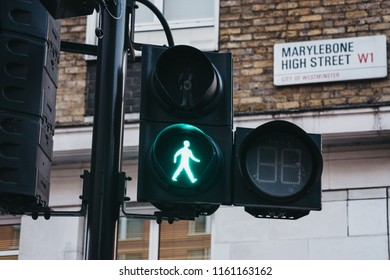 London, UK - July 26, 2018: Green pedestrian light on Marylebone Road, City of Westminster, London borough which occupies much of the central area of Greater London.