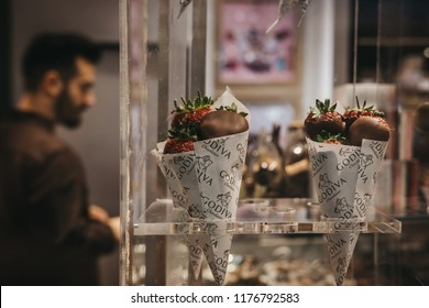 London, UK - July 26, 2018: Chocolate covered strawberries on retail window display of Godiva shop in London, UK. Godiva is a famous chocolate brand that was founded in 1926 in Brussels, Belgium.