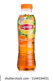 LONDON, UK - JULY 28, 2018: Plastic bottle of Lipton ice tea with peach flavour on white background.