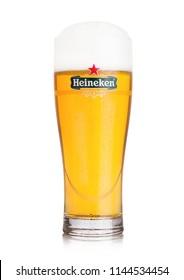 LONDON, UK - JULY 28, 2018: Original glass of Heineken Lager Beer on white  background. Heineken is the flagship product of Heineken International
