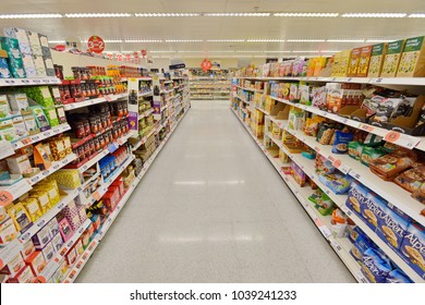 London, UK - July 3, 2014: A general view of a food and drink aisle at a Sainsbury's supermarket. Sainsbury's is the UK's second largest supermarket after Tesco with a revenue of £23 billion in 2013.