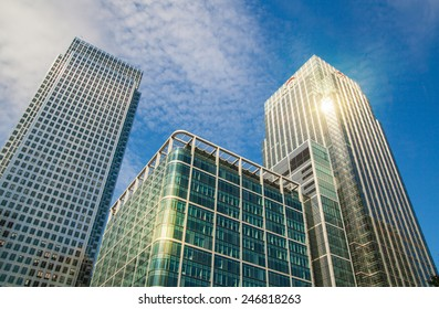 LONDON, UK - JULY 3, 2014: Canary Wharf skyscrapers against blue sky