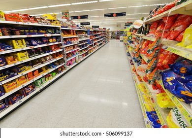 London, UK - July 3, 2014: A general view of an aisle in a Sainsbury's supermarket. Sainsbury's is the UK's 2nd largest supermarket with a revenue of GBP 23 billion in 2013.