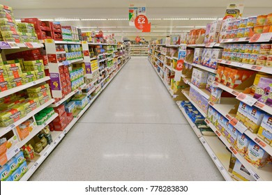 London, UK - July 3, 2014: A general view of an aisle at a Sainsbury's supermarket. Sainsbury's is the UK's second largest supermarket after Tesco with a revenue of £23 billion in 2013.
