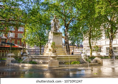 LONDON, UK - JULY 3, 2016. Statue of William Shakespeare built in 1874 in Leicester Square Garden in London, UK