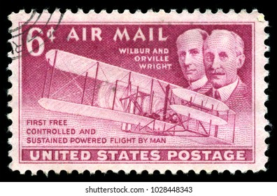 London, UK, July 30 2014 - Vintage 1949 United States of America cancelled postage stamp showing an image  celebrating the 46th anniversary the Wright Brothers first flight