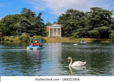 London / UK - July 30 2020:Gunnersbury Park Boating Lake pedalos and swans on a summer day, West London