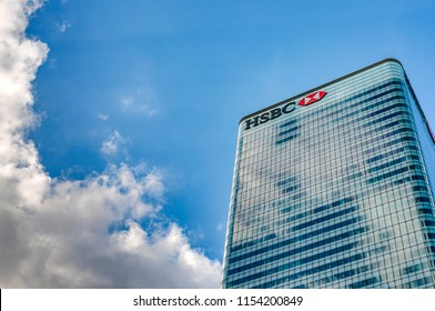 London, UK - July 31st 2018: HSBC Tower HQ (8 Canada Square) against the blue sky and clouds with copy space in Canary Wharf, London, England . It is the main headquarters of HSBC Bank