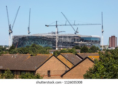 LONDON, UK - JULY 3RD 2018: A view of the new Tottenham Hotspur FC stadium under construction and towering over the suburbs in Tottenham, London, on 3rd July 2018.