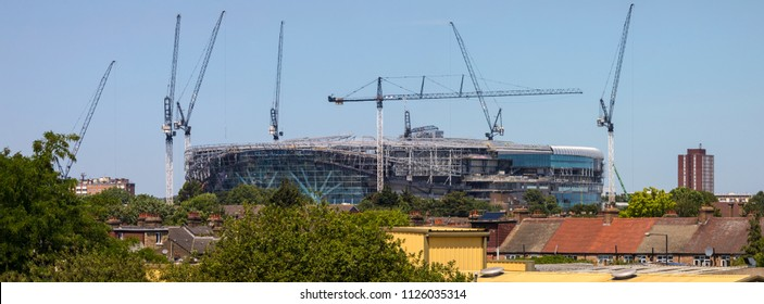 LONDON, UK - JULY 3RD 2018: A panoramic view of the new Tottenham Hotspur FC stadium under construction and towering over the suburbs in Tottenham, London, on 3rd July 2018.