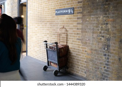London, UK - July 3rd 2019: Platform nine and three quarters at Kings Cross Station, the station has reproduced the platform described in J K Rowling's popular childrens books about Harry Potter