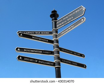 London, UK, July 4 2010 -  retro street signpost giving directions to some of the most famous  landmark attractions