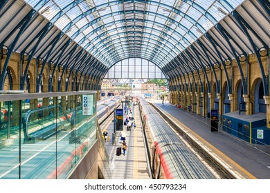 London, UK - July 5, 2016 - Travellers pass along platforms in Kings Cross train station