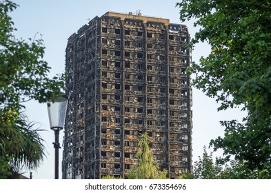 LONDON, UK - JULY 5, 2017:  Charred remains of the Grenfell Tower block of council flats in which at least 80 people are feared to have died in a fire, Kensington, West London.