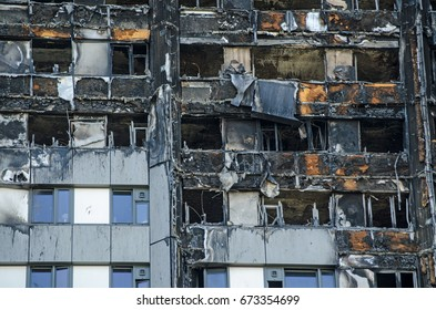 LONDON, UK - JULY 5, 2017:  Close up view of the exterior of the Grenfell Tower block of flats in which at least 80 people lost their lives in a fire.  Remains of exterior cladding can be seen.