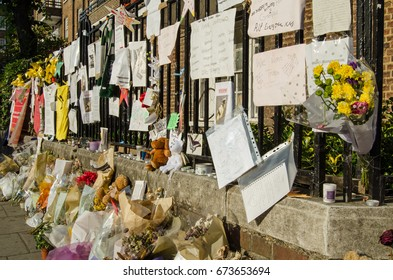 LONDON, UK - JULY 5, 2017: Railings close to Grenfell Tower covered in memorials to those killed and missing.  At least 80 people are thought to have died in the fire in  Kensington, London.