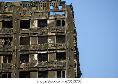 LONDON, UK - JULY 5, 2017: Part of the top floors of the Grenfell Tower block of council flats in which at least 80 people are thought to have been killed following a fire in Kensington, West London.