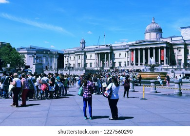LONDON, UK - JULY 6, 2016: People visit Trafalgar Square in London. The square is a part of the City of Westminster and was constructed in 1840s.