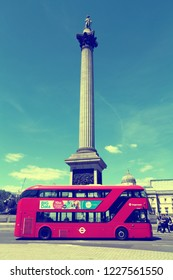 LONDON, UK - JULY 6, 2016: People ride New Routemaster bus at Trafalgar Square, London. The hybrid diesel-electric bus is a new, modern version of iconic double decker.