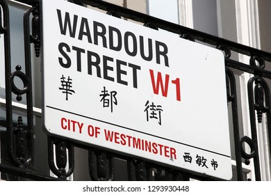 LONDON, UK - JULY 6, 2016: Wardour Street sign in Chinatown district of London, UK. There is a minority of 433,000 British Chinese people in the UK.