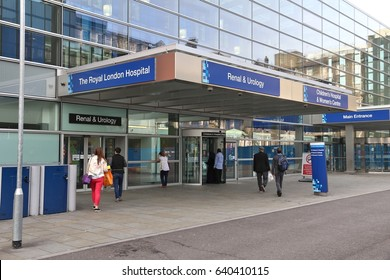 LONDON, UK - JULY 6, 2016: People enter Royal London Hospital in the UK. RLH is part of Barts Health NHS Trust.