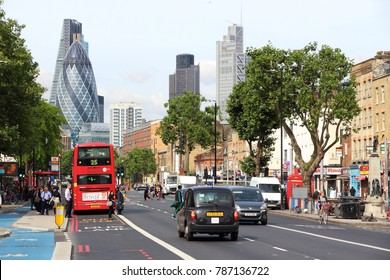 LONDON, UK - JULY 6, 2016: People visit Aldgate area in Whitechapel, London, UK. London is the most populous city in the UK with 13 million people living in its metro area.