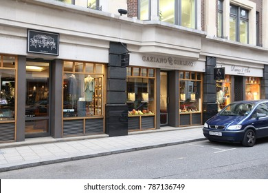 LONDON, UK - JULY 6, 2016: Savile Row bespoke tailoring stores in London. Savile Row is a street in Mayfair, traditionally known for tailors.
