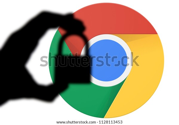 LONDON, UK - JULY 6th 2018: Google Chrome security issues. Silhouette of a hand holding a padlock infront of the google chrome logo