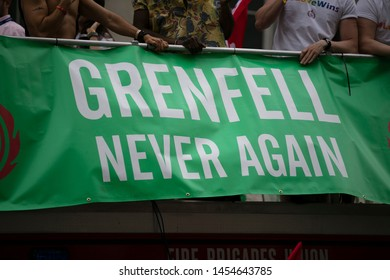 LONDON, UK - July 6th 2019: People hold a Grenfell never again sign in memory of the genfell tower disaster