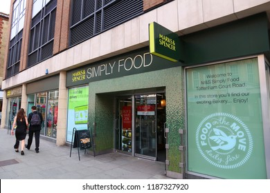 LONDON, UK - JULY 7, 2016: People walk by Marks & Spencer Simply Food grocery store in London. Simply Food is a special convenience store format by Marks and Spencer.